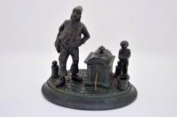 Patinated bronze inkwell, Charles X style dresser