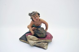 Inkwell polychrome regule - child lying on a rock